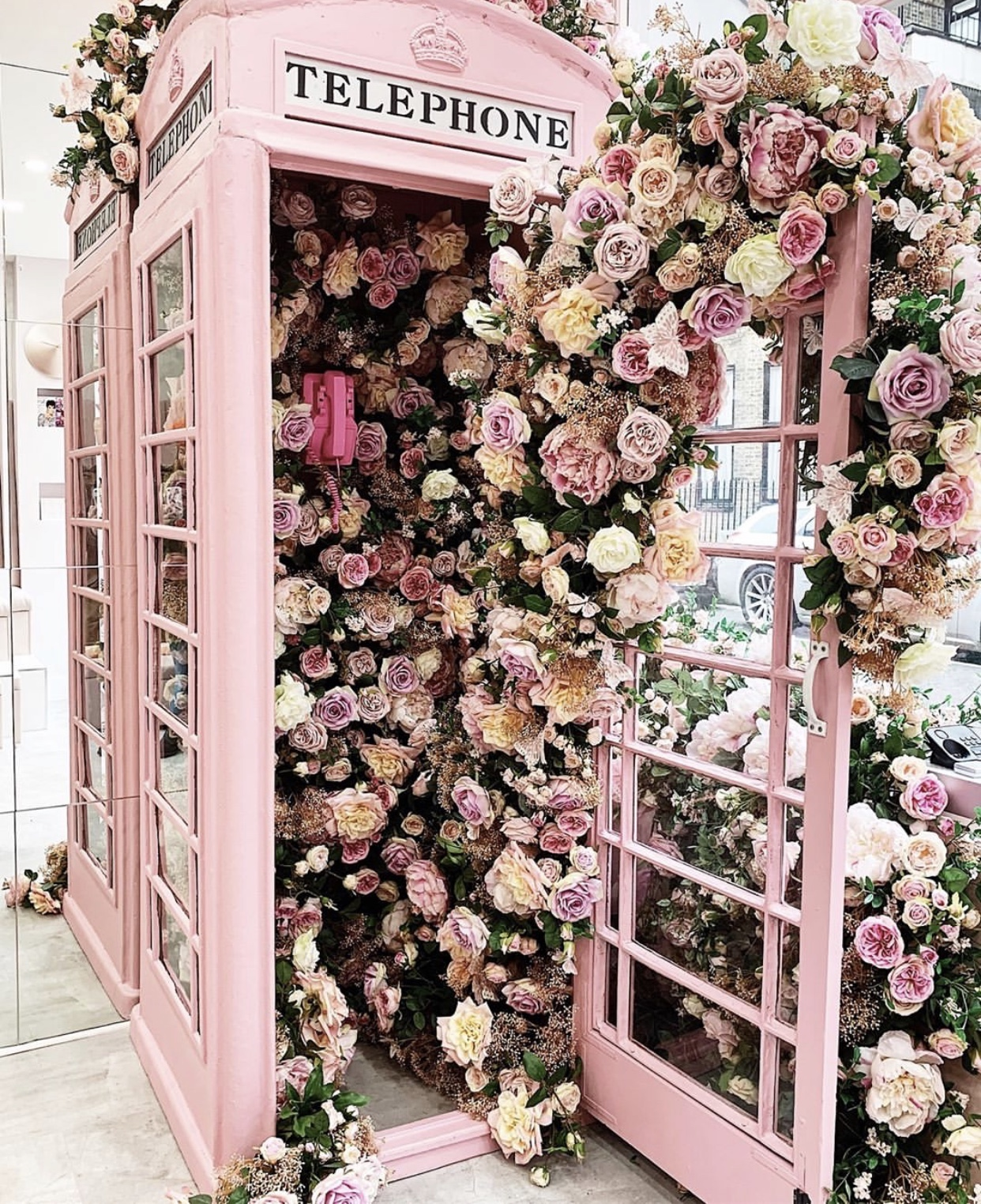 Pink London Phone Booth with Flowers.jpg