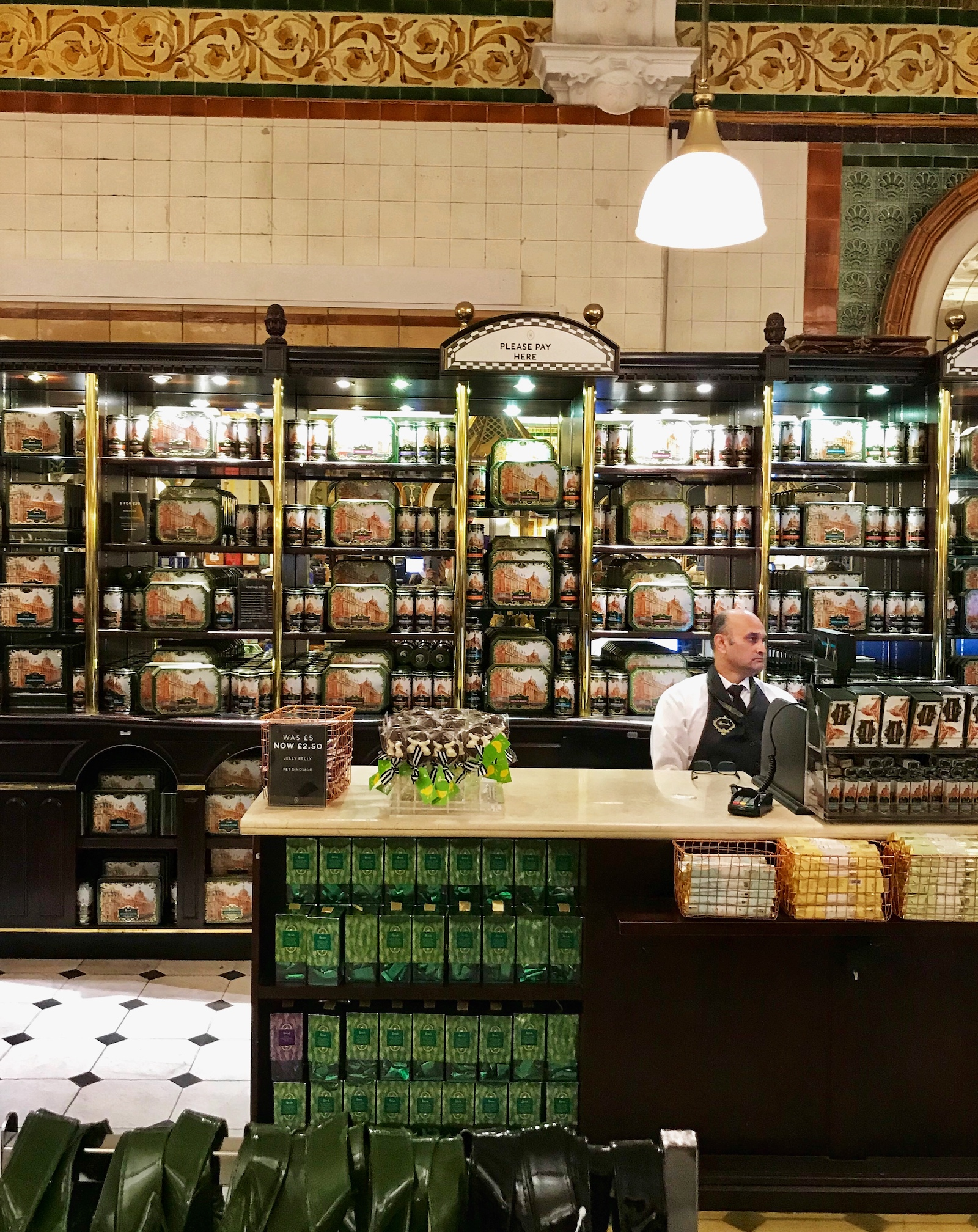 Man Behind Counter In Harrods.jpg