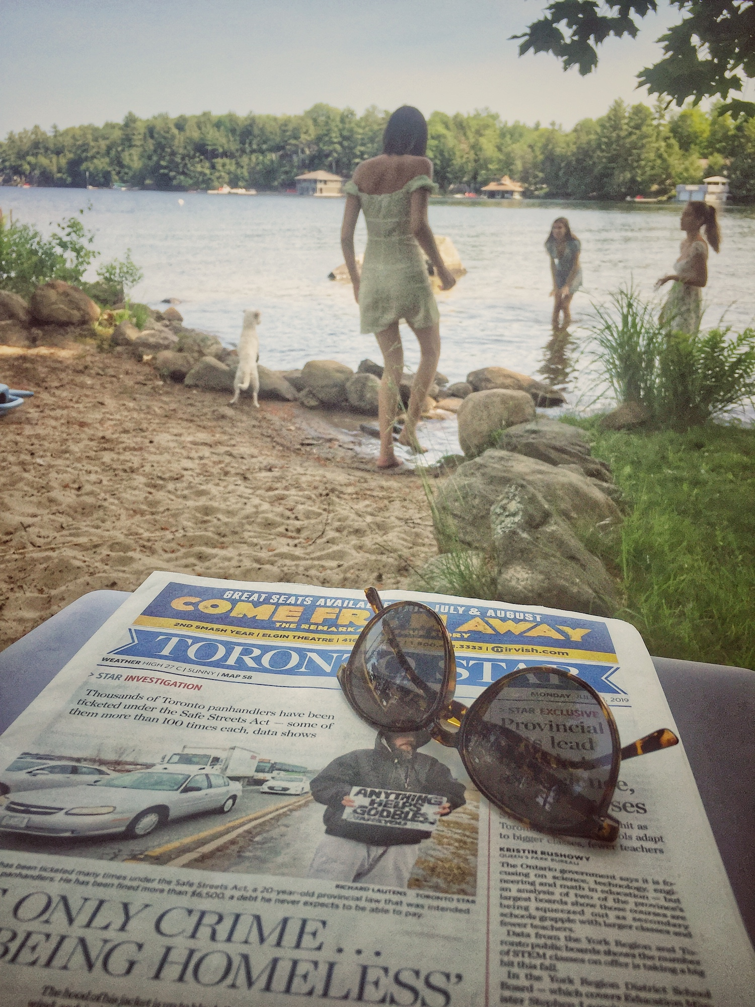 Reading the paper by the lake .jpg