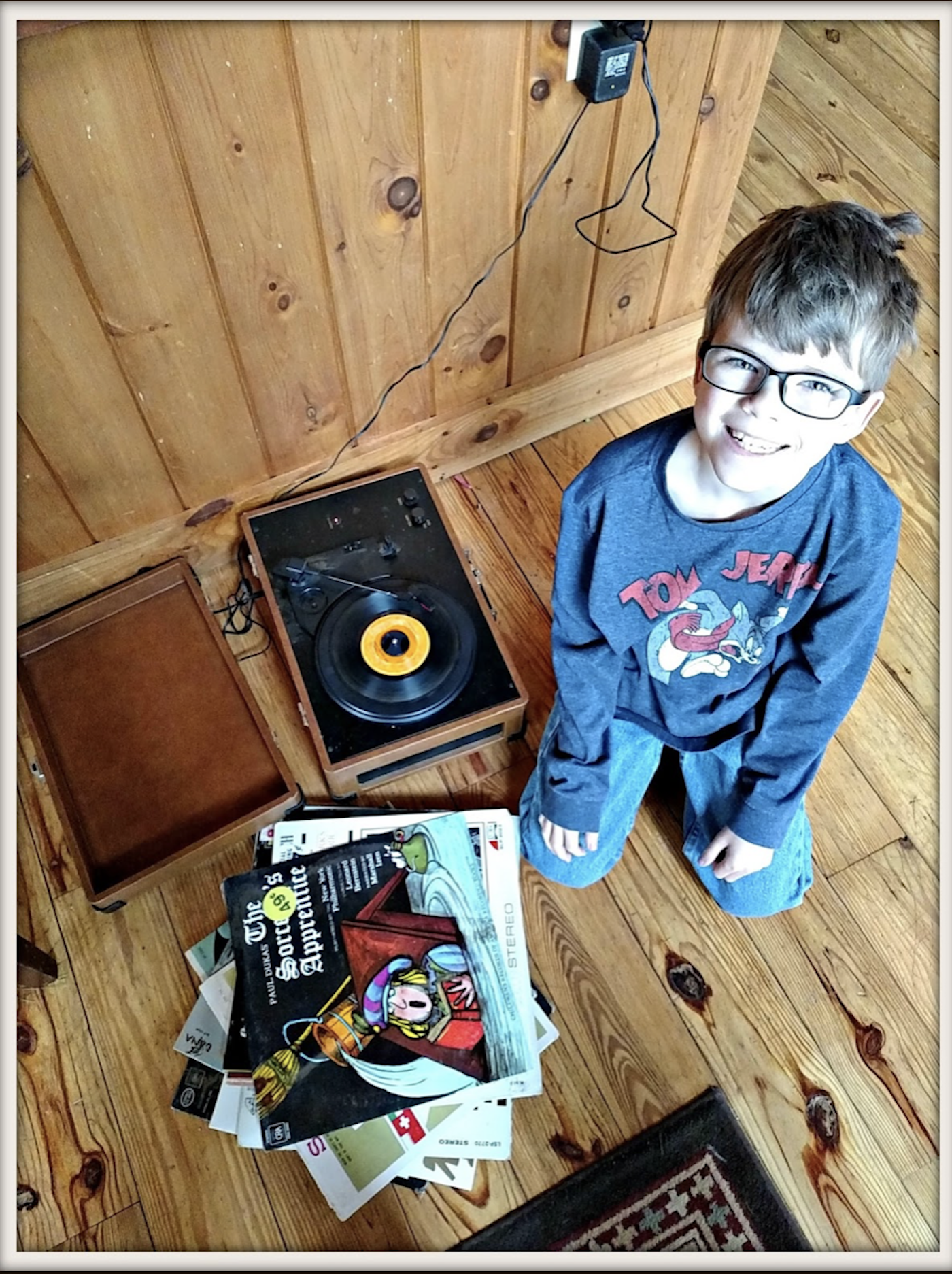 Little boy playing records .png