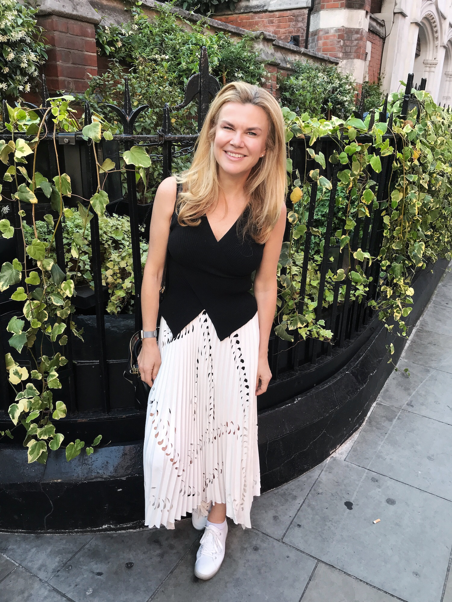 A Broad In London outside Chiltern Firehouse London. Sporting White Trainers.jpg