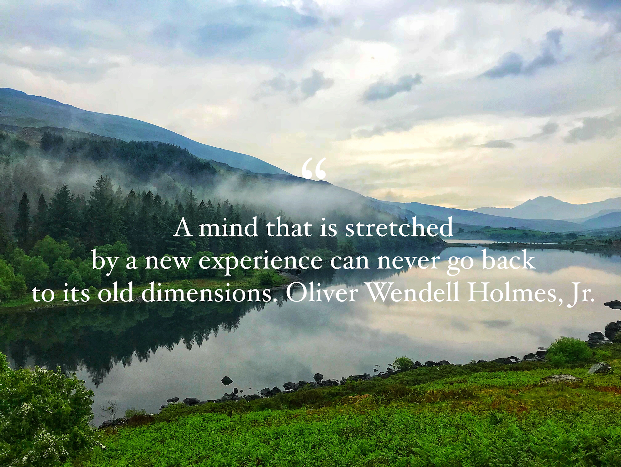 A mind that is stretched...travel quote.PNG