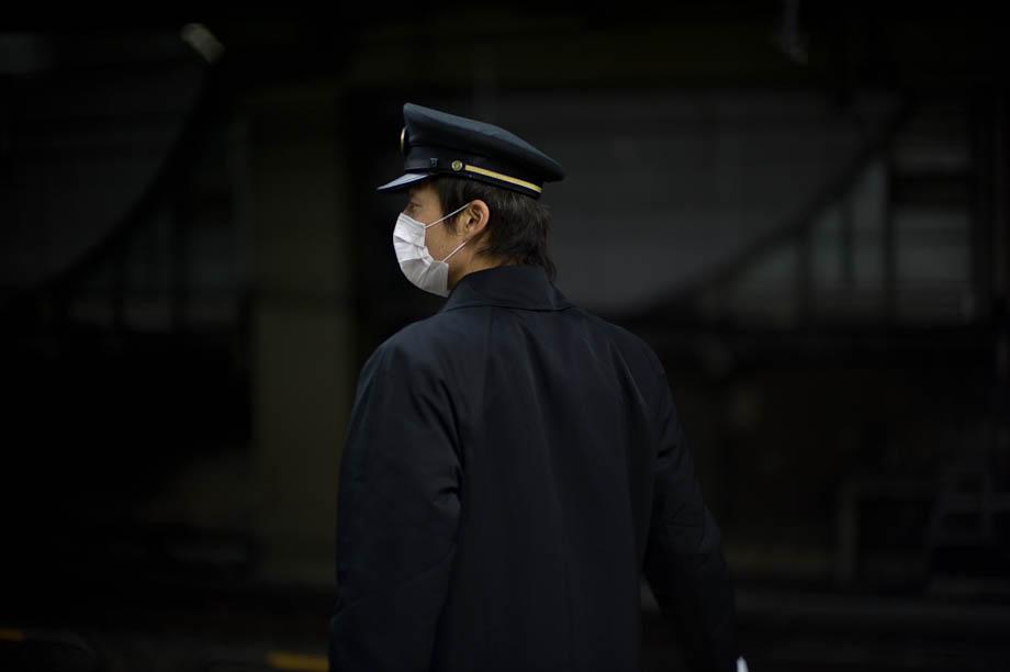 Train conductor at Shibuya Station in Tokyo