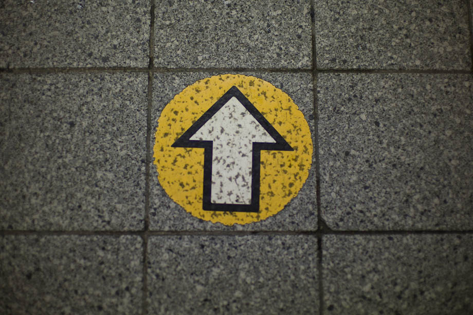 Yellow arrow at Shibuya Station in Tokyo, Japan