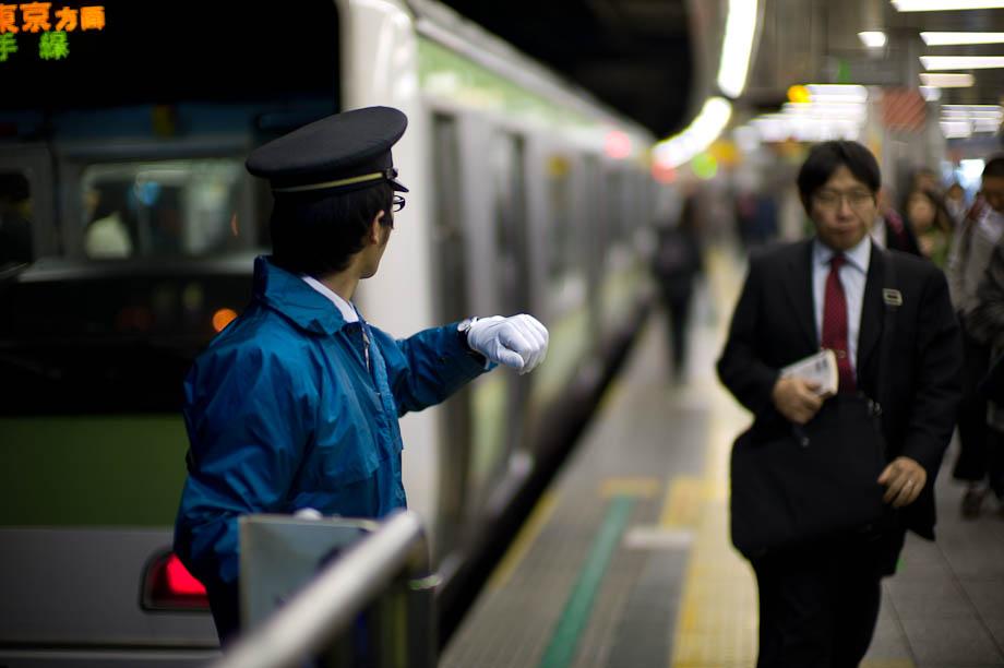 Timing the train at Shibuya Station in Tokyo, Japan
