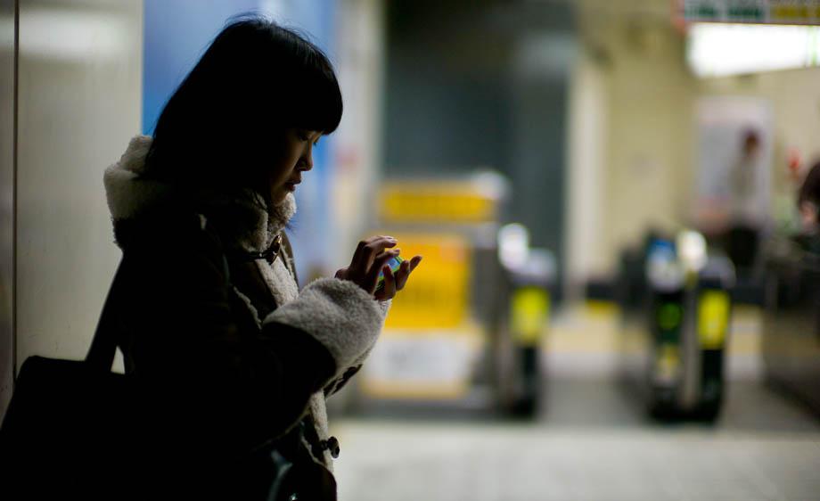 A girl texting at Shibuya Station