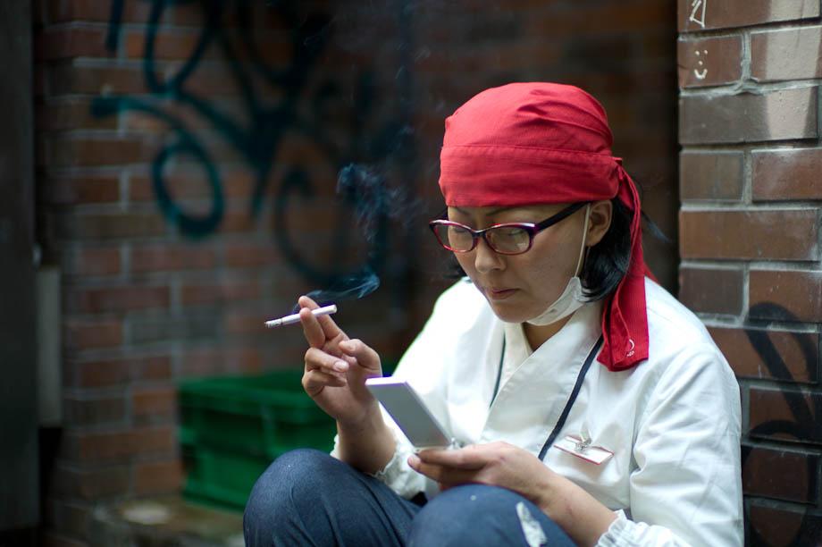 A woman checks news on her phone in Shibuya