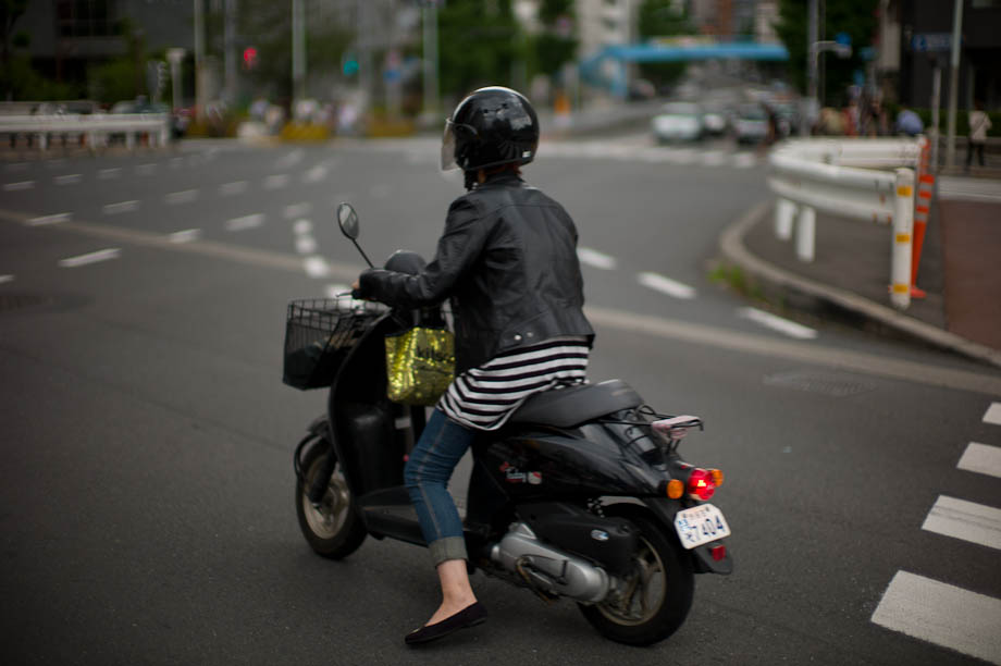Girl on a moped in Nakameguro, Tokyo, Japan