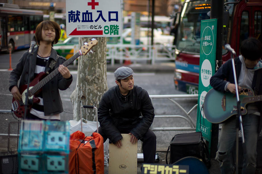 Bands outside train stations in Tokyo