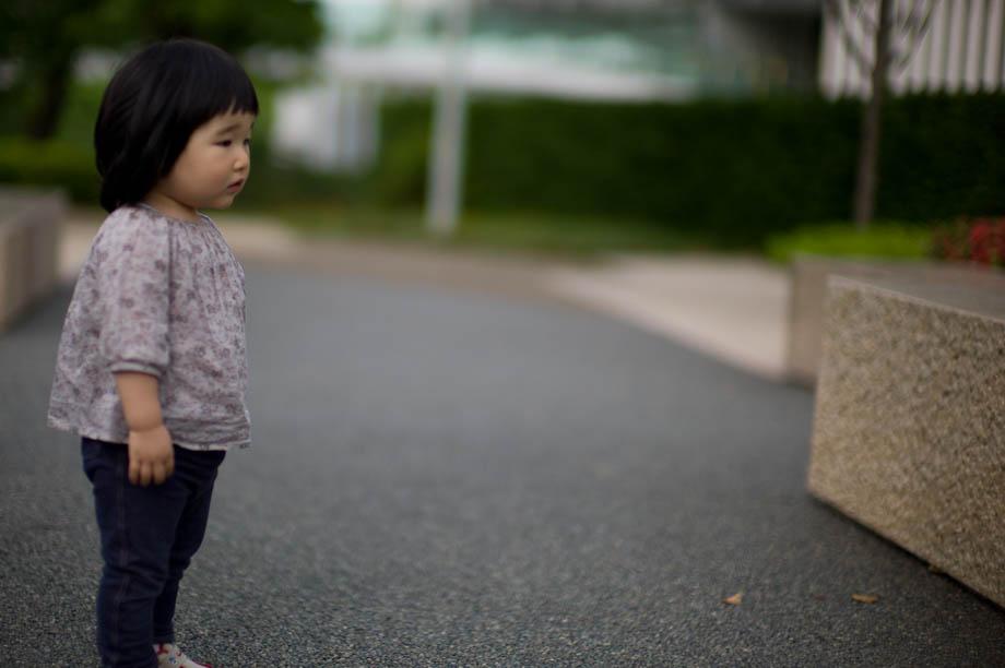 Little girl in park next to Tokyo Midtown