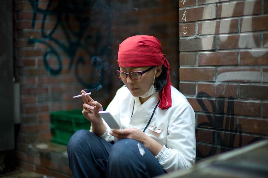 Checking news on Mobile Phone in Shibuya