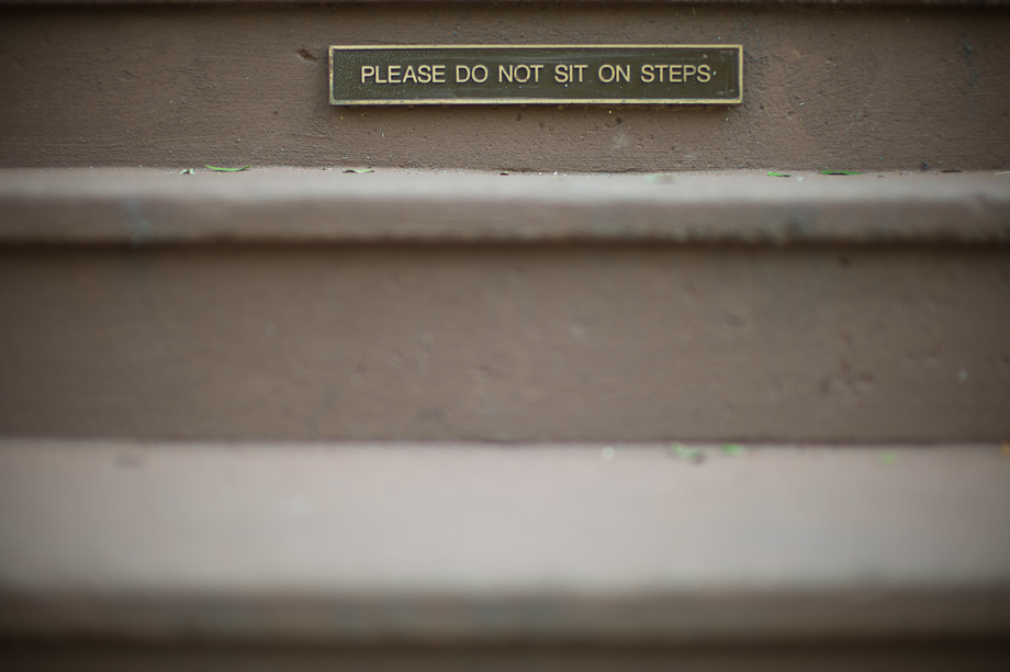 Please do not sit on the steps on Newbury Street in Boston