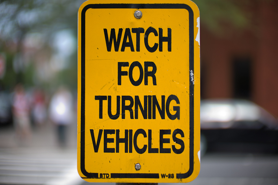 Watch for turning vehicles  on Newbury Street