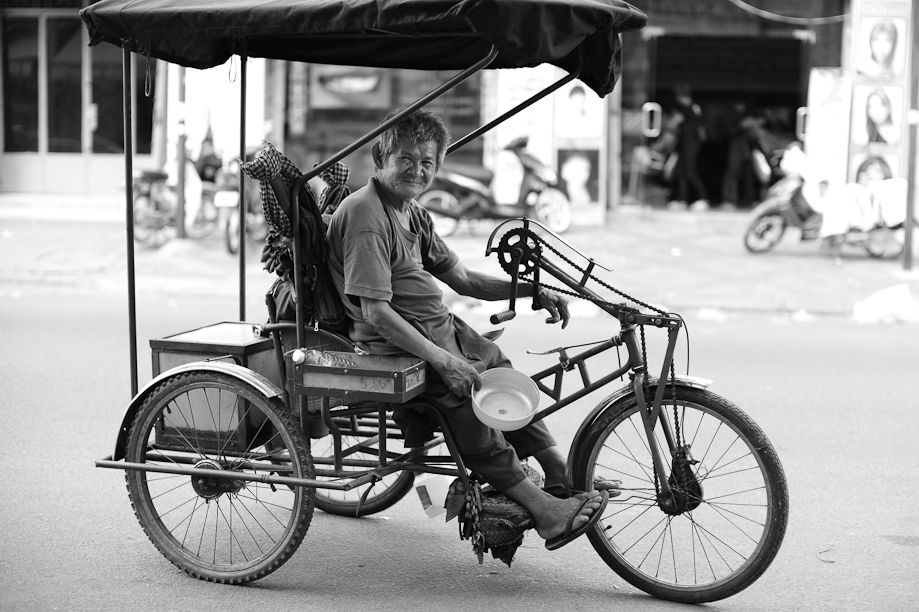 Man on a bike in Phnom Penh, Cambodia