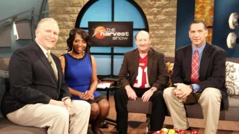 Author, speaker and NCAA record holder, Dr. Emmet C. (Tom) Thompson II, recently appeared as a guest on The Harvest Show. Pictured: (  Third from R  ): Thompson and The Harvest Show co-hosts (L to R): Chuck Freebyl, Valerie Lowe, Thompson and Stefan Radelich. (Dr. Emmet C. (Tom) Thompson II photo)