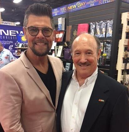 Get a Kick Out of Life  author Dr. Emmet C. (Tom) Thompson II met with Grammy and Dove award  winner  Jason Crabb during the CBA UNITE 2018 International Christian Retail Show last week in Nashville.  (McCain & Co. Public Relations photo)