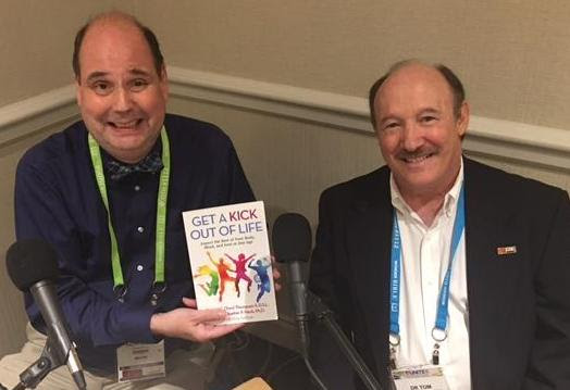 Author Tom Thompson was interviewed about his fascinating book,  Get a Kick Out of Life , at the recent CBA UNITE convention in Nashville, Tennessee, by Bob Crittenden from The Meeting House/Faith Radio. Pictured (L to R) are Crittenden and Thompson. (McCain & Co. Public Relations photo)
