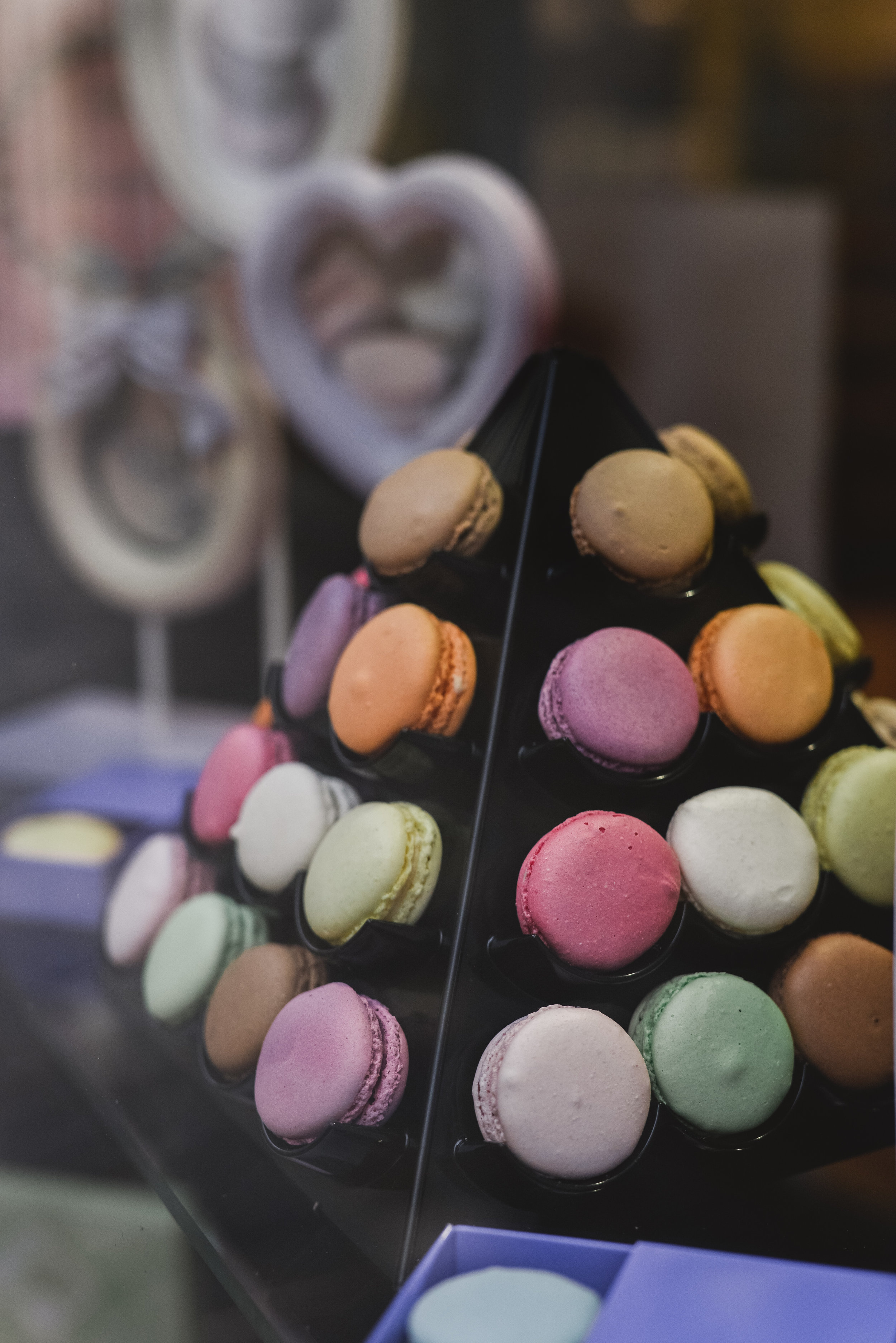 Hand made macaroons in a shop window