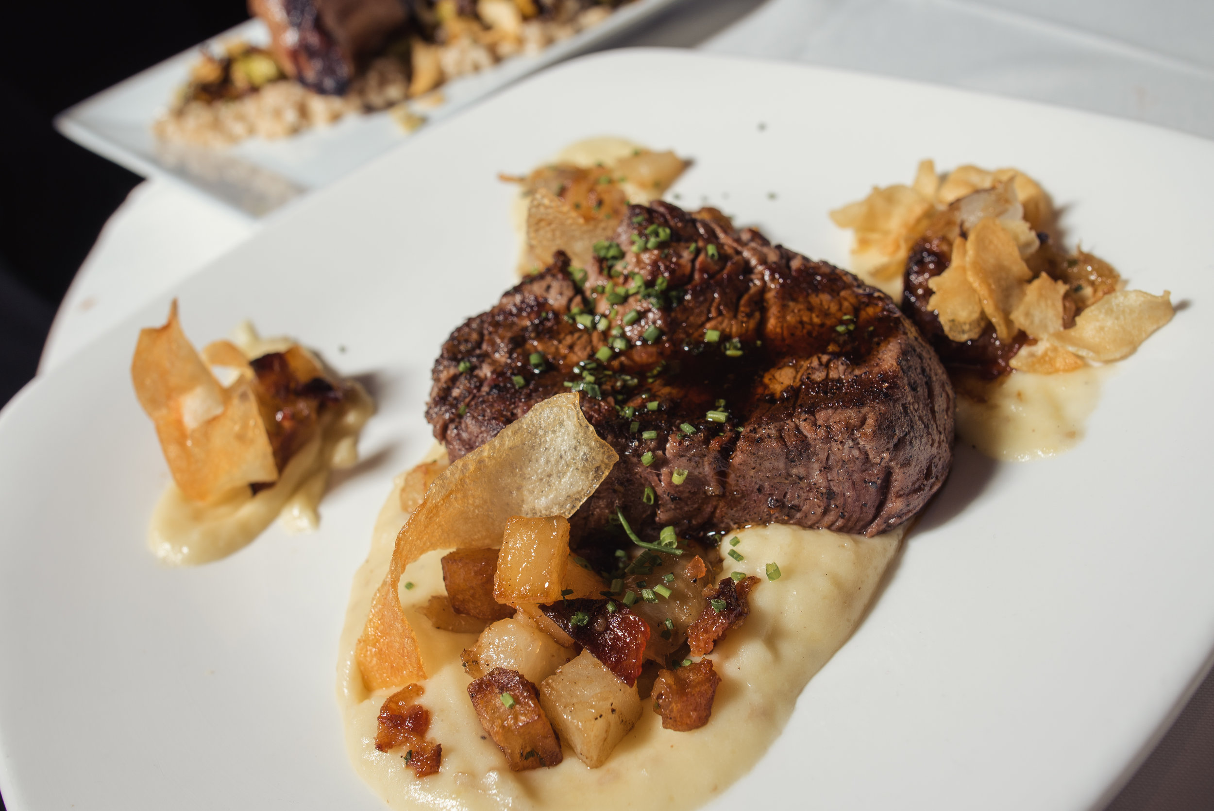 Melt-in-the-mouth filet, Aerie style: Truffle mash, confit dice potato, candied bacon, roasted cipollini onion, jus