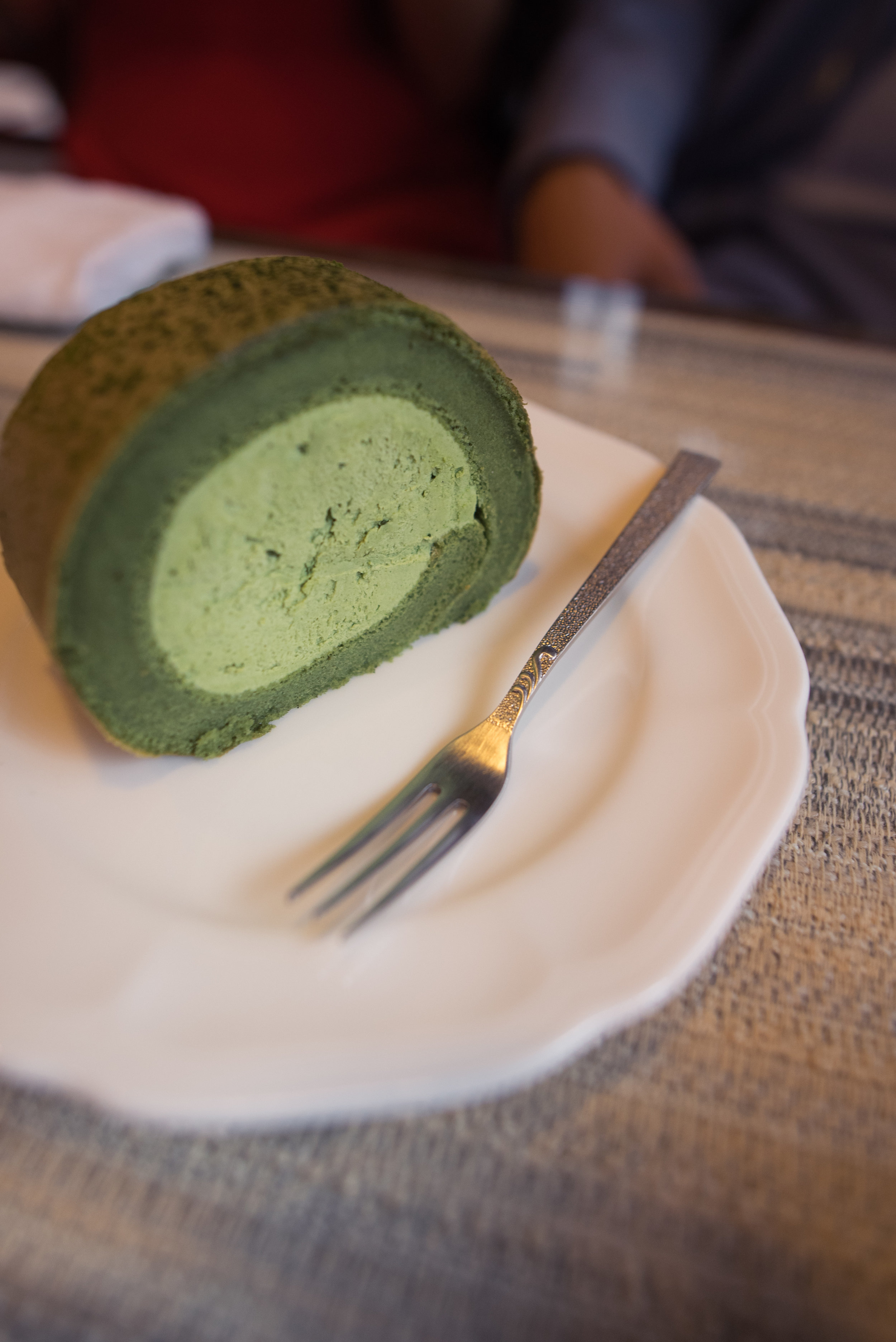 Sampling our first taste of matcha cake. It was incredibly moist and not overly sweet.