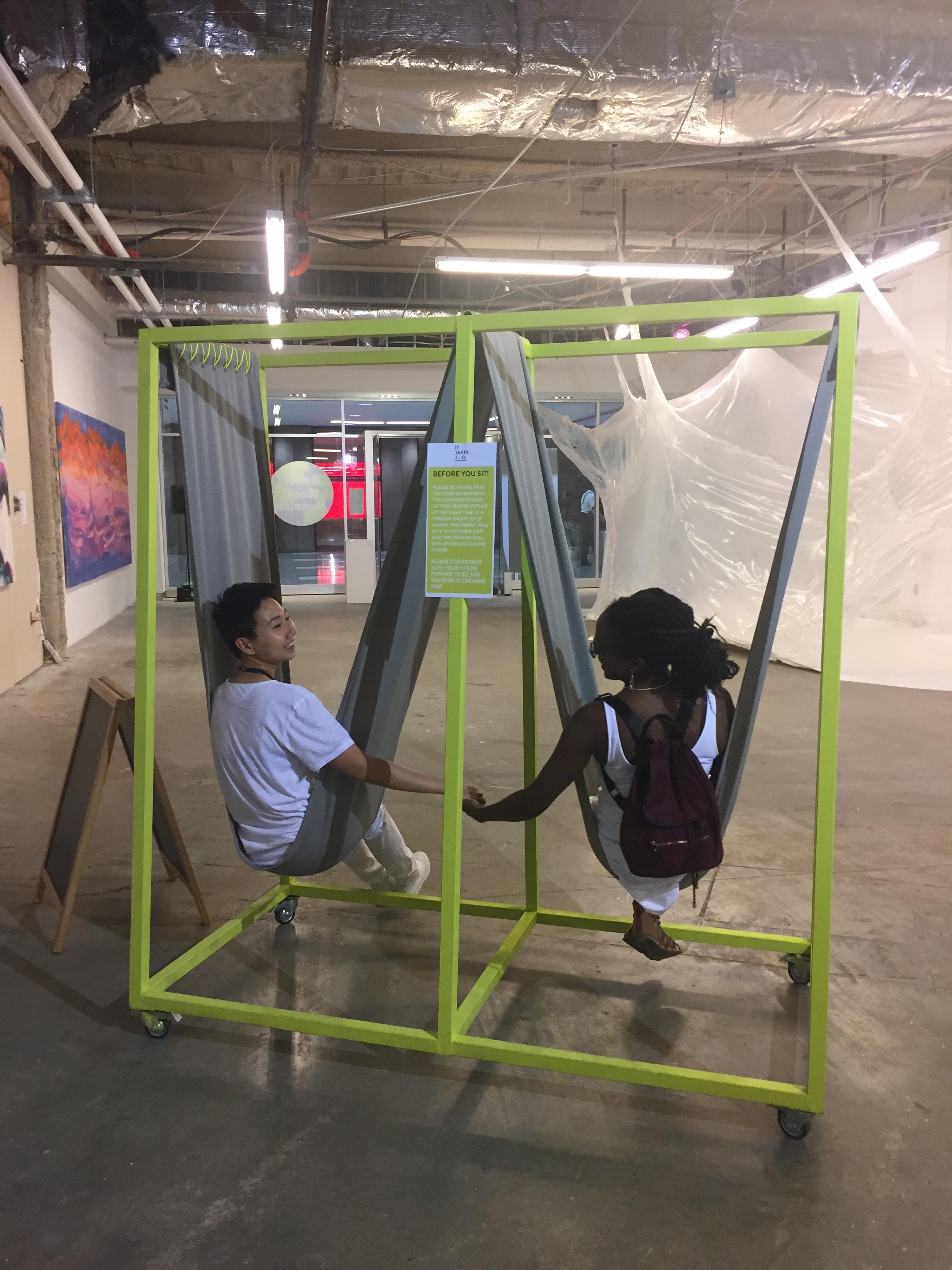 """It Tales Two"" Zoe Cinel, Frankie Jose Skar, 2017. Frankie Yu and Janell holding hands."