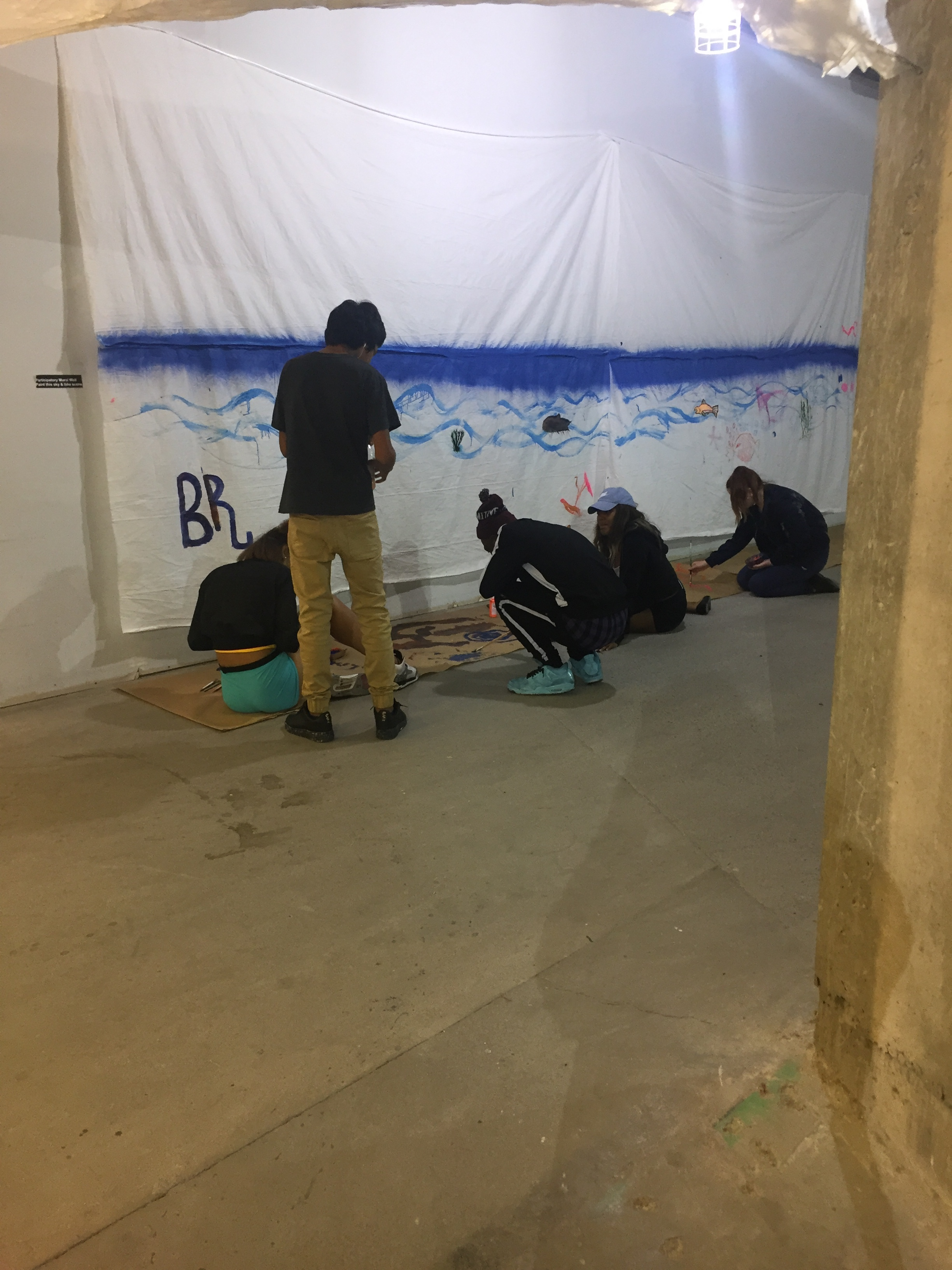 """Visitors painting in """"Bde Maka Ska"""""""