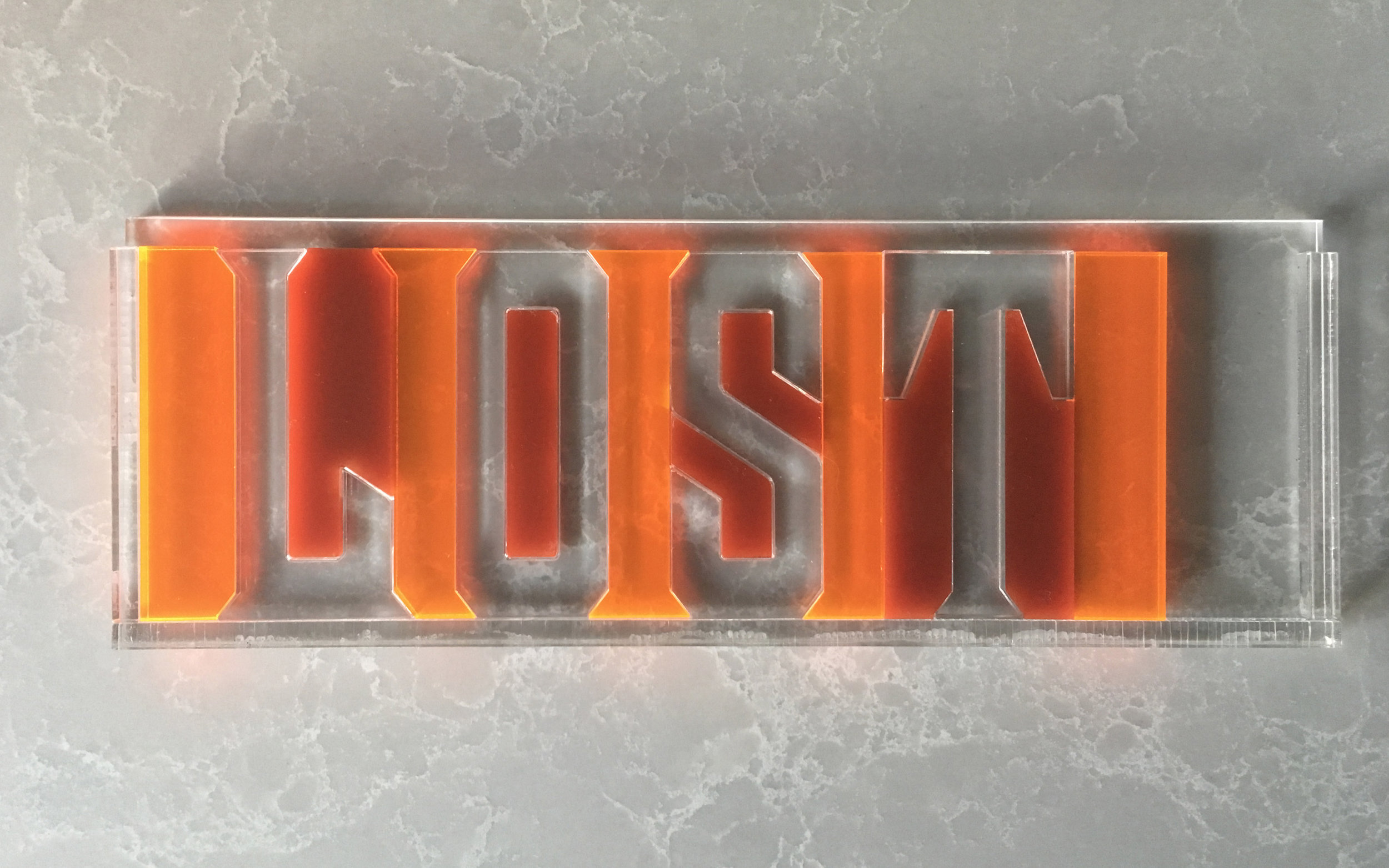 Neon-orange spacers in a variety of widths allow students to experiment with letter spacing. Proportions are based on letterpress standards. Shown here are 6/em spacers.