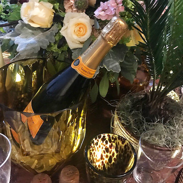 Beautiful shot of a beautiful setting! Faux crystal champagne bucket glows. Let's pop that bottle already!