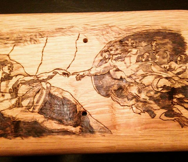 """Michelangelo's """"Adams creation"""" burned onto the bottom of a new heaven and earth pipe holder. #art #smoke #jacksonvillefl #pipes #woodworking #custom #reclaimedwood"""
