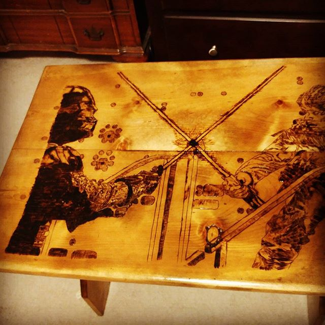 """Well the #starwars end table is now officially up for sale. If you are a #vader and #darkside fan or if you are a #skywalker and #lightside fan this is the ultimate addition to your collection. It measures 25.75""""L x 18""""W x 20.75""""H.  #woodworking #woodburning #art #lightsaber #sithlord #cosplay #fanboy #theforceisstrongwiththisone #furniture #custom #fanart #wood"""