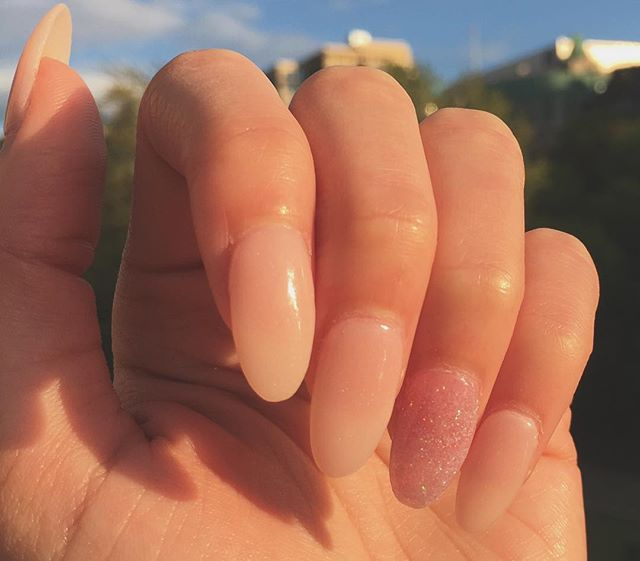 """Long, lovely almond-shaped nails with an accent for wedding season. We are one of the very few (if not only) nail specialists in the region who do SNS Dipping Powders, an alternative to acrylic nails. The process is odorless and results in a natural, gentle wear. Customers can pick from a variety of pre-pigmented or natural powders. Ask us for """"Jelly Dip"""" - $45 Full Set - $30 Fill. ⋅ ⋅ ⋅ #nails #nailswag #nailart #nail #naildesigns #nailstagram #naildesign #nailsoftheday #nailpolish #shellac #bellevueshellac #bellevuenailsalon #bellevue #nailsofinstagram #snsdippingpowder #acrylicnails #gelnails #fauxnails #artificialnails #weddingseason"""