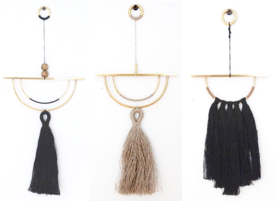 Wall hangings of brass with linen fibre tassels made by Cindy Hsu Zell of WKNDLA, in California.From left: Nightfall, $120; Mini Horizon in grey, $120; Mini Sunset, $120.