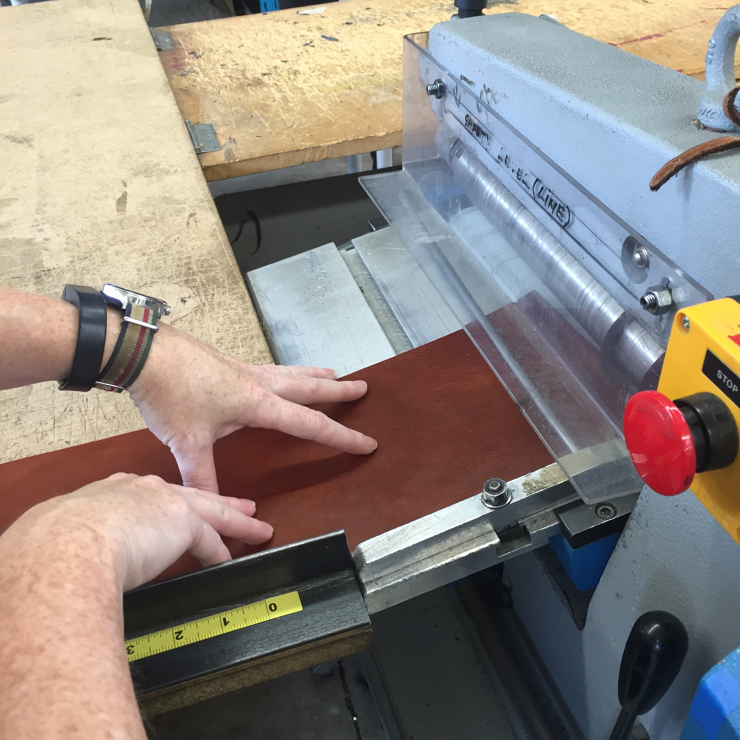 1. The leather is cut to width. Yes, those are my hands feeding it into the cutting machine!