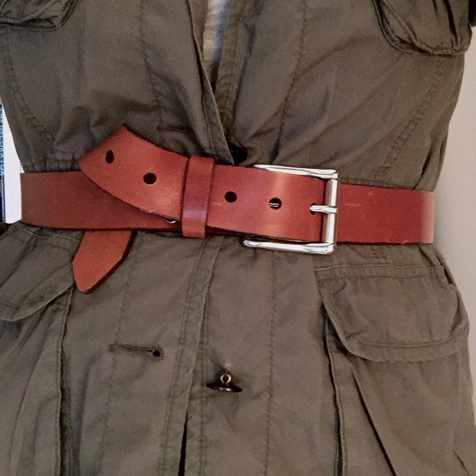 MILITARY STYLE:cinched over an army jacket.