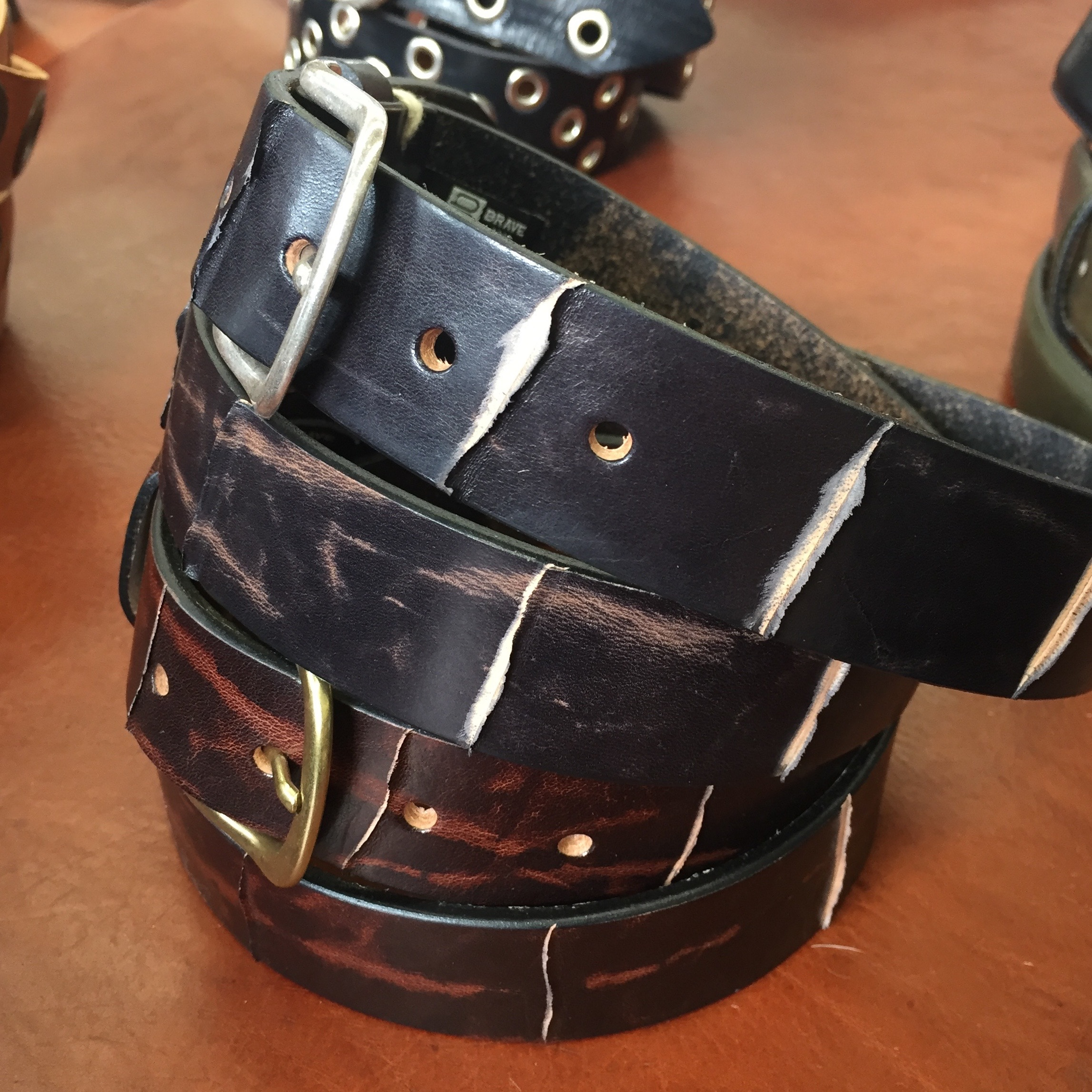 These mens belts have an interesting sliced detail that's a bit punky and deconstructed.