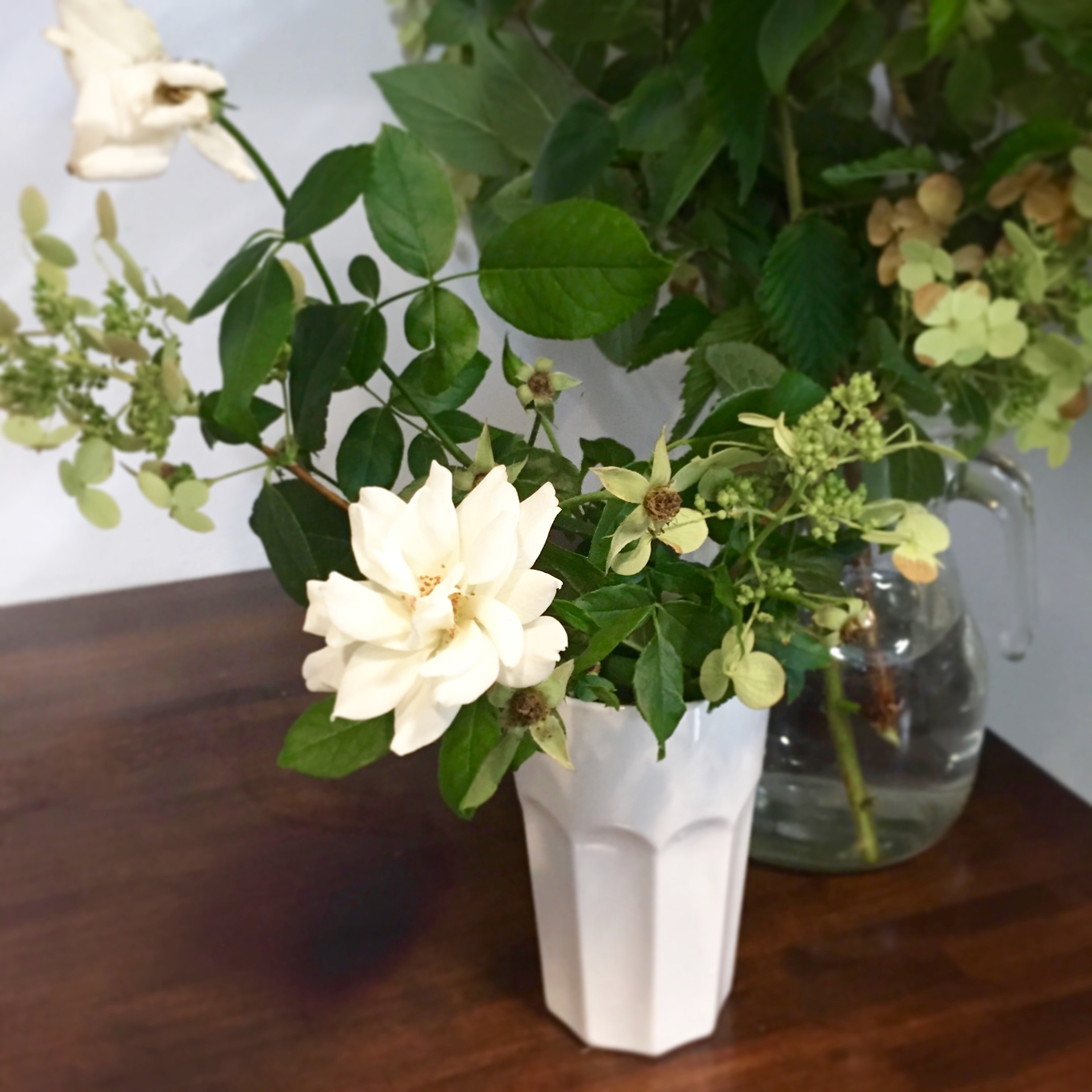 foraged flowers standing by