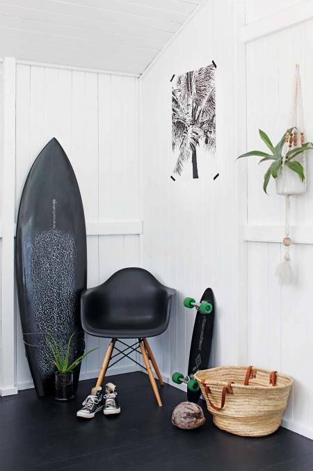 A Queensland home with a strict black and white palette and a great looking little board tucked in a corner. Design:  Simone Barter Design Studio .