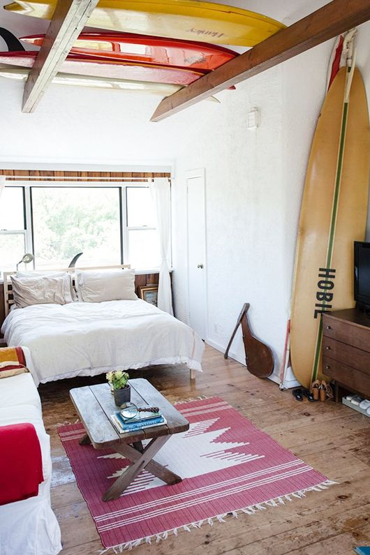 Mikey DeTemple' s oceanside hideaway in Montauk, NY packed with old beach treasures including several vintage boards.Photos: Zak Bush.