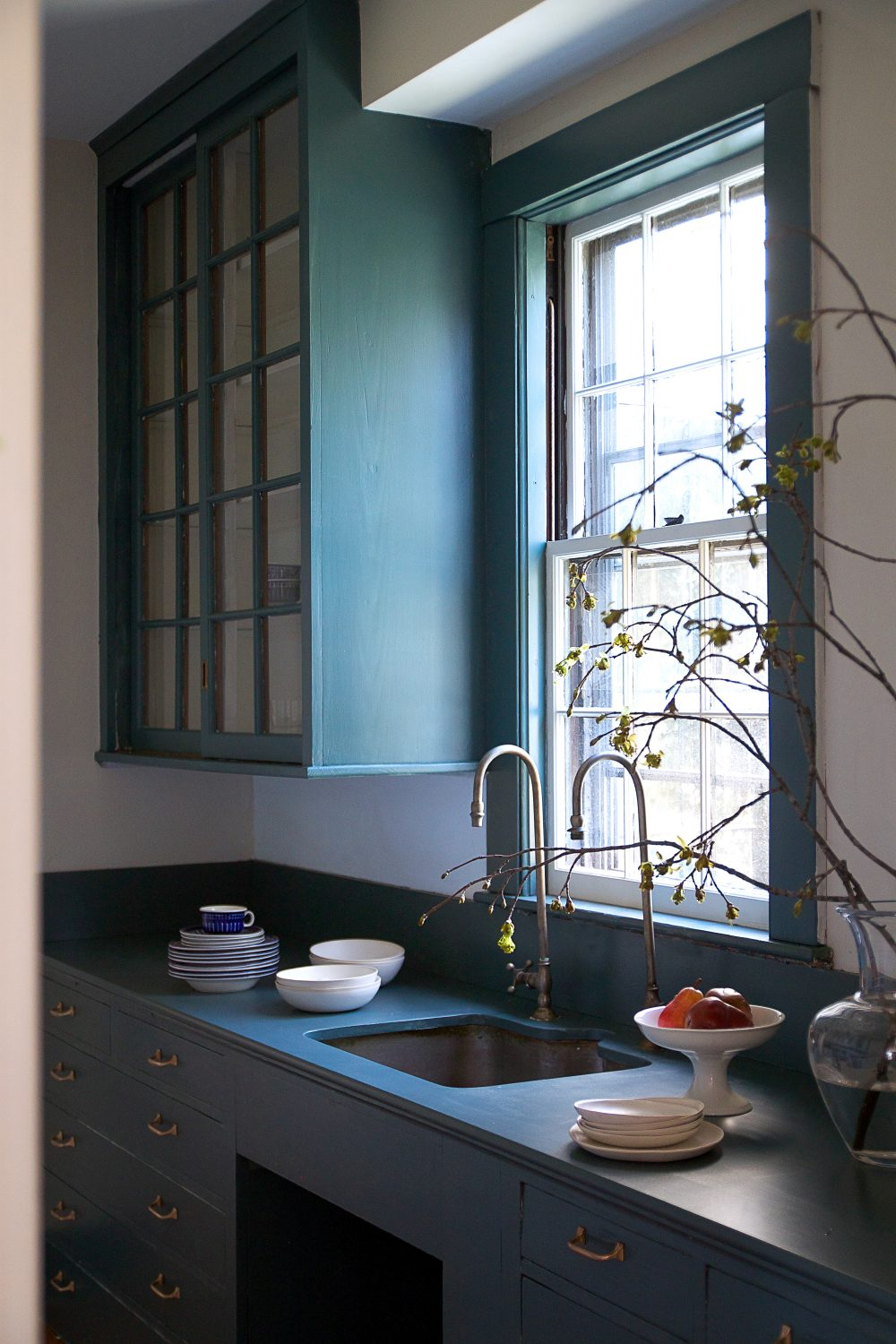 Justine Hand painted a butler's pantry, including counter, in Inchyra Blue.