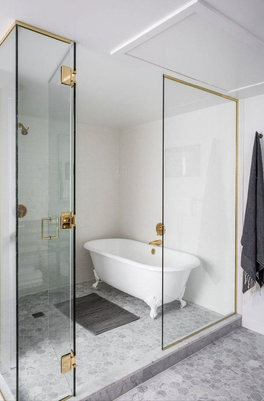 One of the biggest trends in bathroom design now -- a floor plan that combines the bath and shower. I don't always love it but I sure do here. Design:  Nicole Hollis  for the Palladian Hotel. photo: Laure Joliet