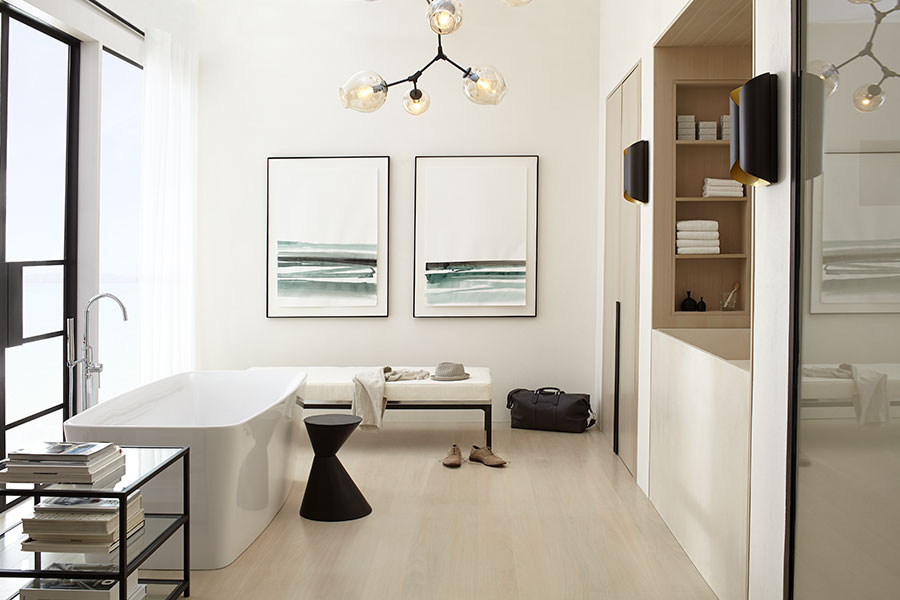 The serene space may be minimalist but is far from lacking in detail. Love the addition of artwork by Canadian artist  Zoe Pawlak . And inside the cabinet on the right is a coffee station and wine fridge. Yasssss!