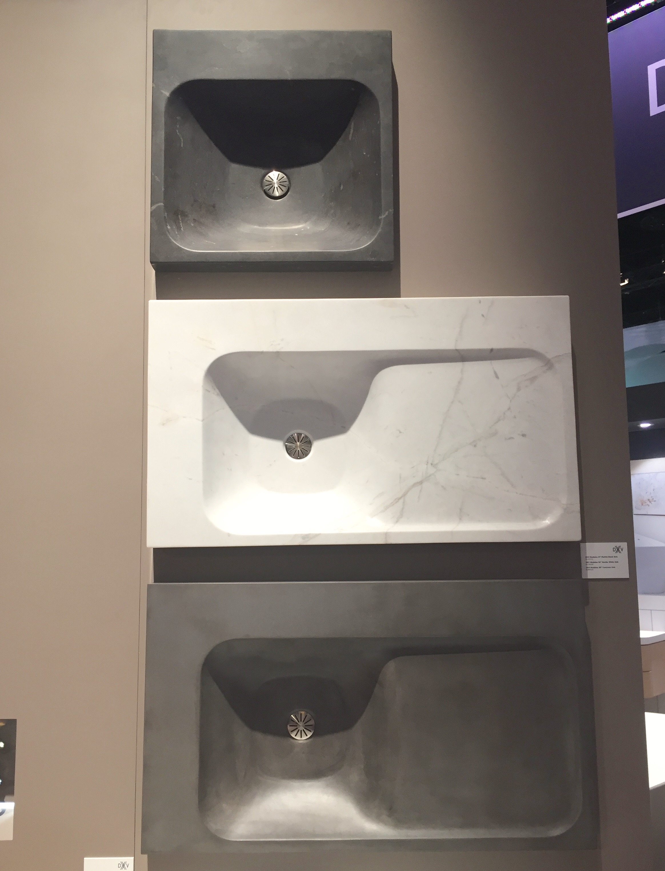 In addition to solid surface material, Modulus sinks come in (from top) black marble, white marble and concrete. Gorgeous!