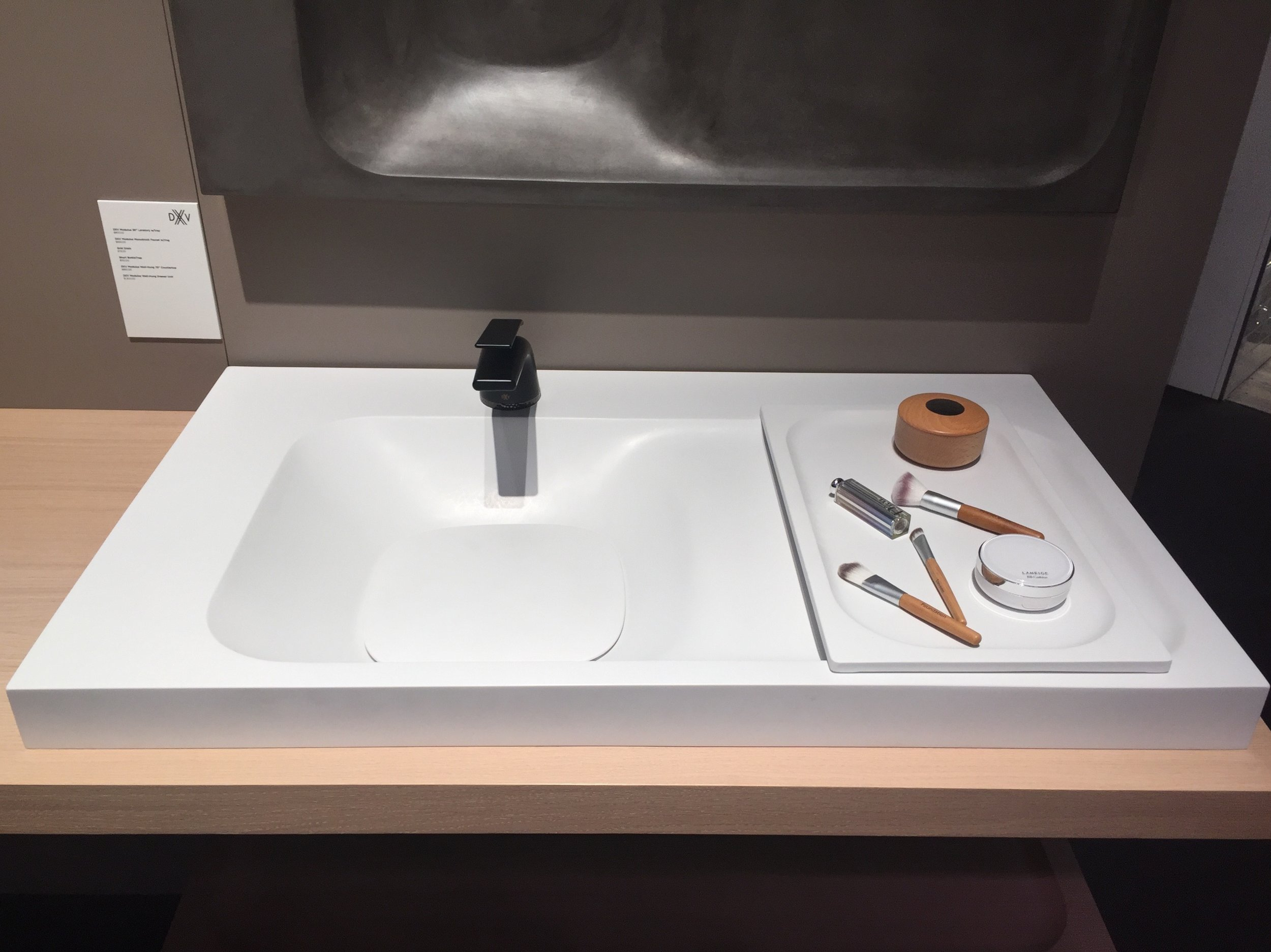 The sink includes this handy tray that acts as a dry zone without requiring additional counter space. Love the large drain cover.