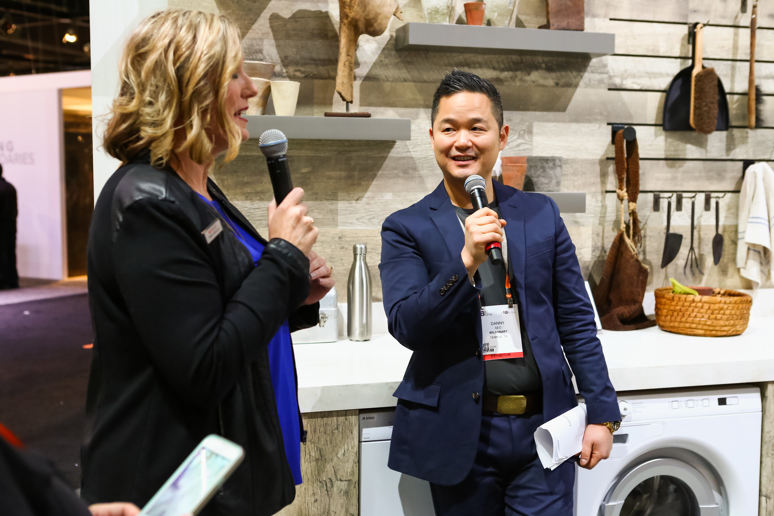 Danny Seo leads a tour of the Wilsonart stand at KBIS 2017.  photo: Felix O.B./FXO Photography.