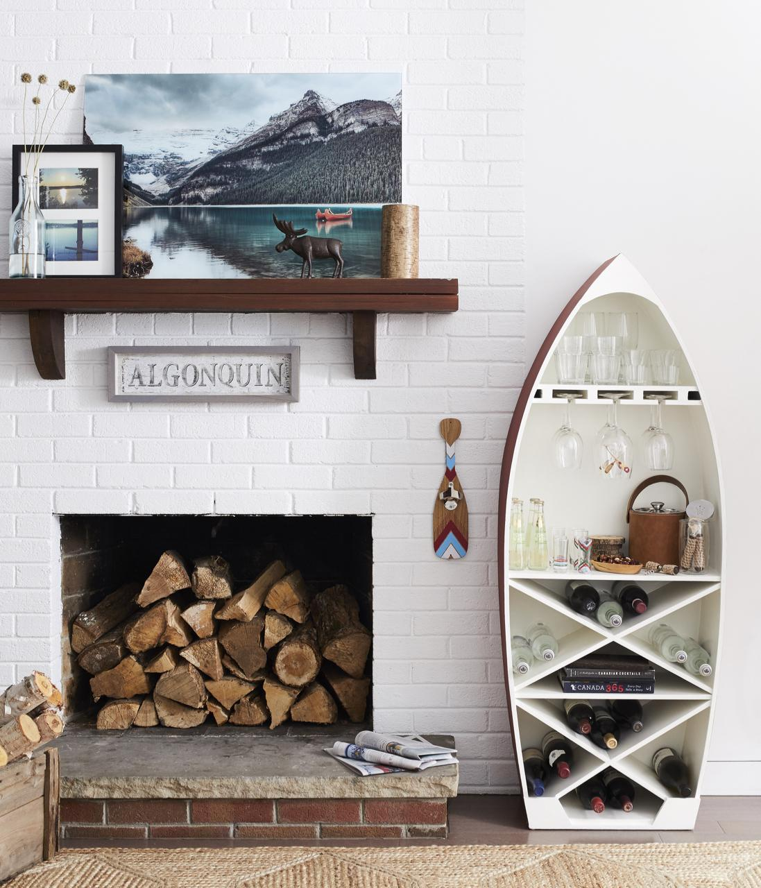 I thought the dory boat bar cabinet was a cutie — could not resist featuring that one. That photograph art of Lake Louise is an absolute stunner and printed on glass. We giggled on set about how the moose sculpture is placed so it looks like he's walking on water.