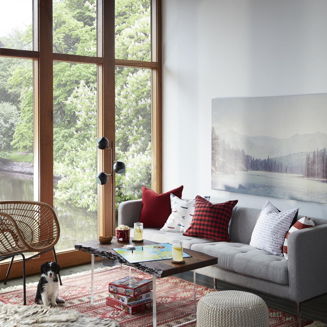 My favourites in this shot are the giant overscale photo canvas, the wicker chair (!!!), the red and black check cushion and of course THE PUPPY. I love my job extra extra when there's a puppy on set.