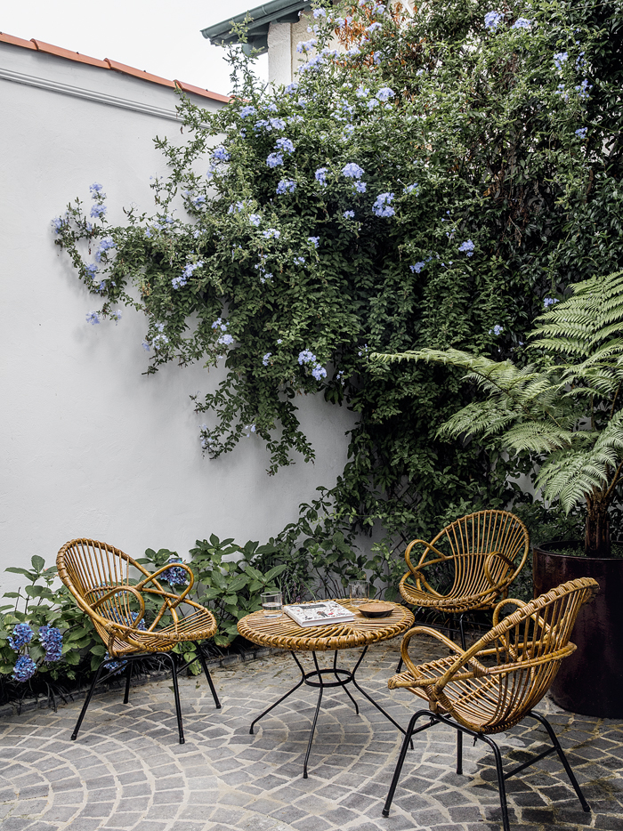 The heavenly outdoor terrace features a killer vintage rattan set — also flea market finds.