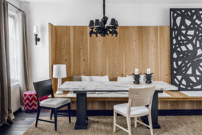The dining area features table and chairs by the designers. The sconce and chandelier are by Christian Astuguevieille.