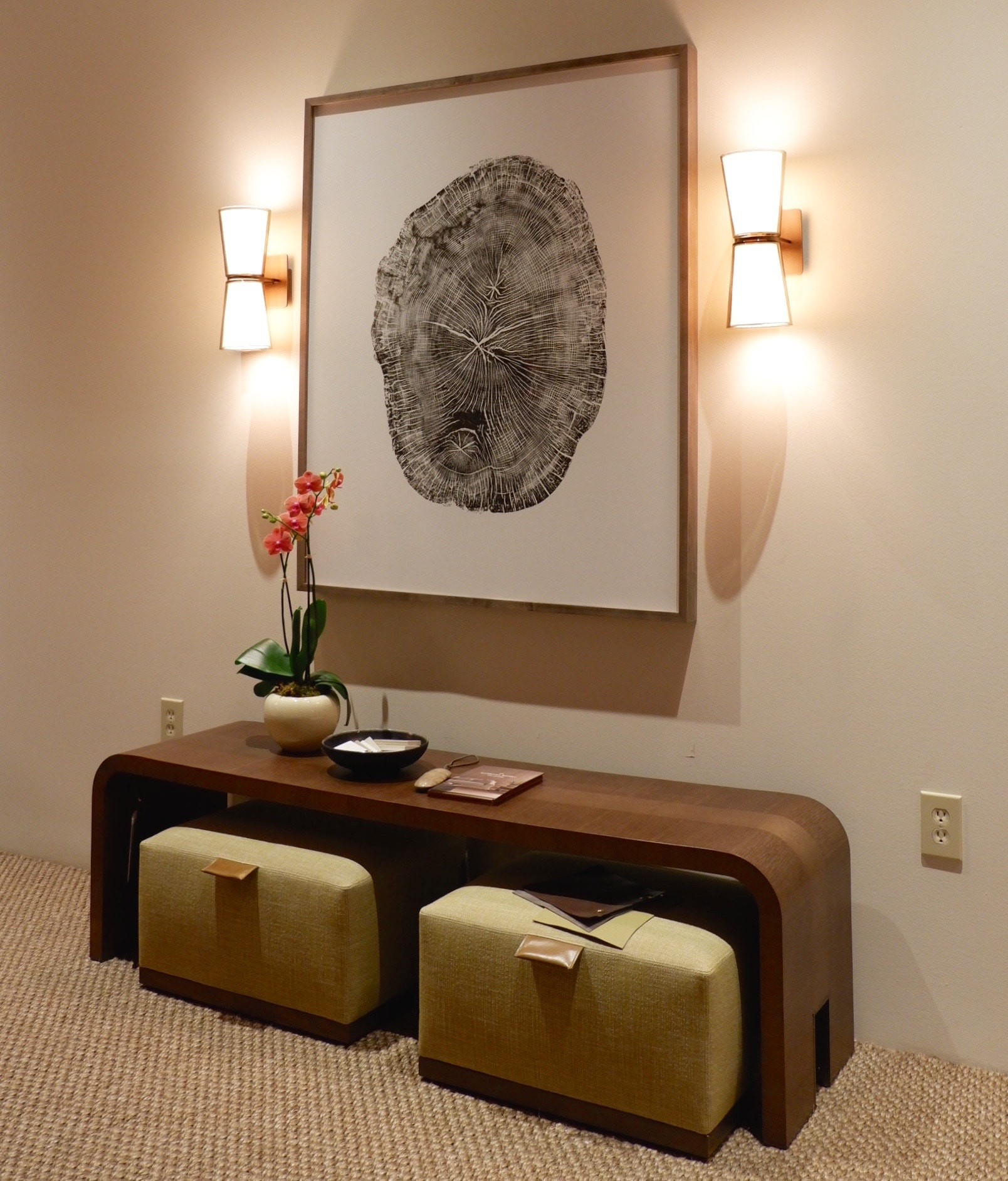 Barbara Barry for Baker Furniture. Tree slice artwork, quiet colour palette, low slung furniture, mellow warm wood.