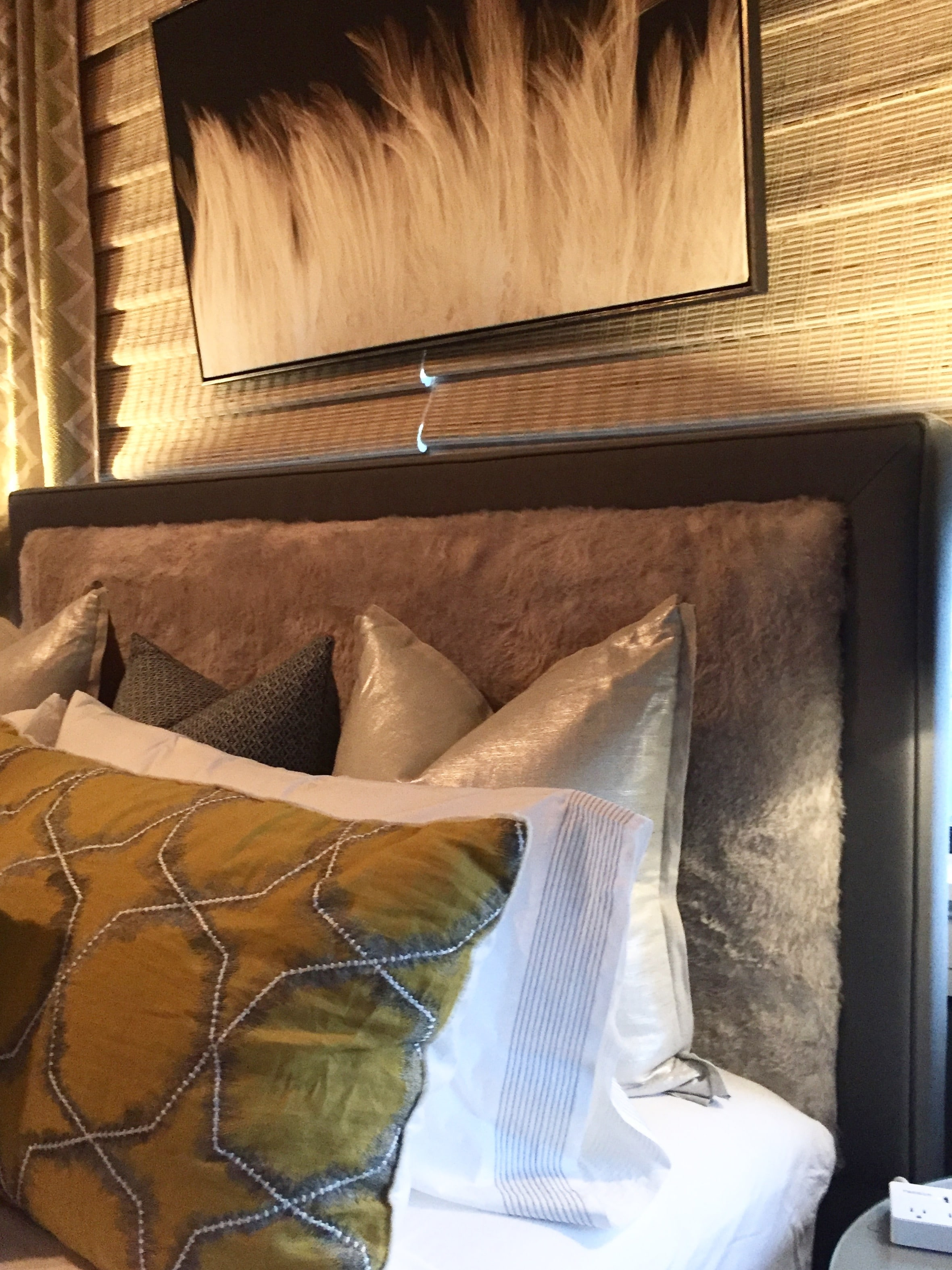 The sexy furry upholstered headboard in a room designed by Thom Felicia for Eastern Accents at the Pandora's Manor Bed & Breakfast showhouse, which was being held in High Point concurrent to the furniture expo.